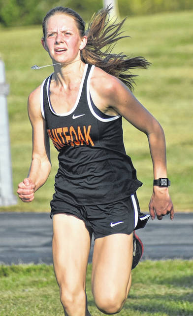 Lydia Kittner is pictured above. She won first place in the varsity girls race.