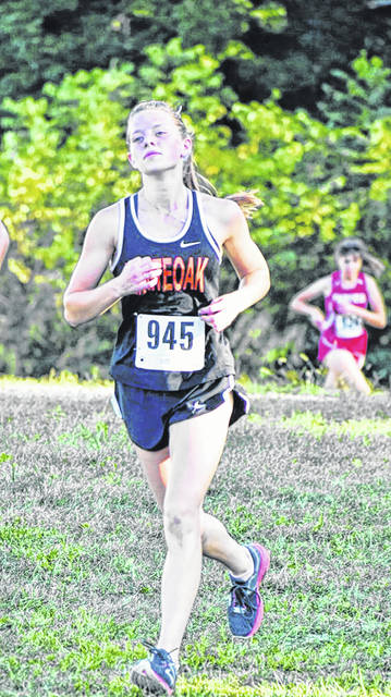 Lydia Kittner of the Whiteoak Lady Wildcats, coming across the finish line at the Highland County Invitational