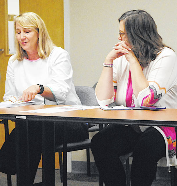Nan Cahall, left, a representative from Sen. Rob Portman's office, spoke Thursday at the Highland County Drug Abuse Prevention Coalition meeting. Also pictured is Fairfield High School Secretary Kevy Jones.