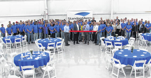 More than 300 employees, managers and elected officials were on hand for a ribbon-cutting ceremony Friday at the Hillsboro StandardAero plant.