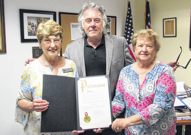 Recognizing the sacredness of the document that shapes the foundation of America, Hillsboro Mayor Drew Hastings issued a proclamation Monday proclaiming the week of Sept. 17-23 as Constitution Week in the city of Hillsboro. Tuesday, Sept. 17 will mark the 223rd anniversary of the drafting of the U.S. constitution. Shown, from left, are Jane Stowers of the Waw-wil-a-way chapter of the Daughters of the American Revolution, Hastings, and Highland County Historical Society Director Vicki Knauff. Fellow DAR member Judy Hornsby was unable to attend.