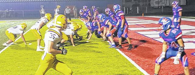 McClain Tigers lineup on the 1 1/2 yard line in what proved to be the winning touchdown with 18.5 seconds left in the 4th quarter. #9 Burns takes the ball in for the score.