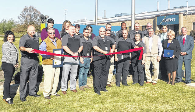 Adient employees, elected officials and others are pictured at a ribbon-cutting signifying the longtime Greenfield business joining the Highland County of Commerce.