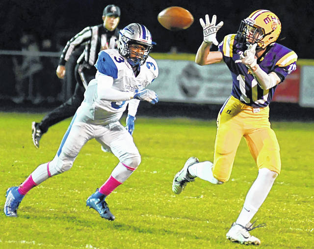 Seth Wise catches a pass for the Tigers from Sam Faulconer in photo shown above