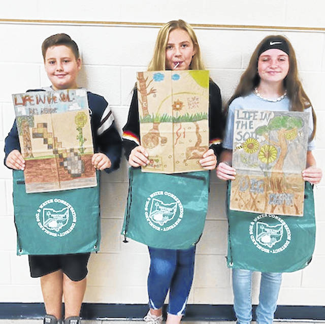 The poster contest winners from Bright Local Middle School included, from left, Conner Wiscaver, Iceces McKeever and Kara Deatley.