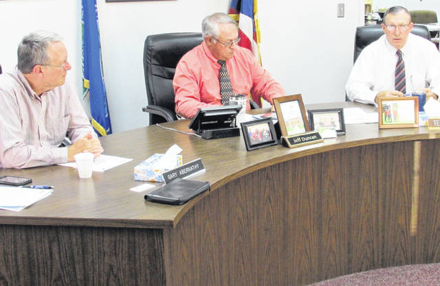 From left, Highland County commissioners Gary Abernathy, Jeff Duncan and Terry Britton attending to business during Wednesday's regularly scheduled meeting.