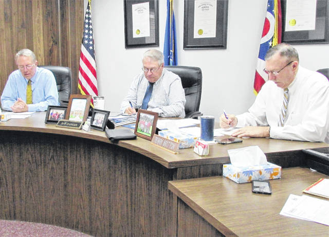 Shown from left, are commissioners Gary Abernathy, Jeff Duncan and Terry Britton during Wednesday's regular meeting.