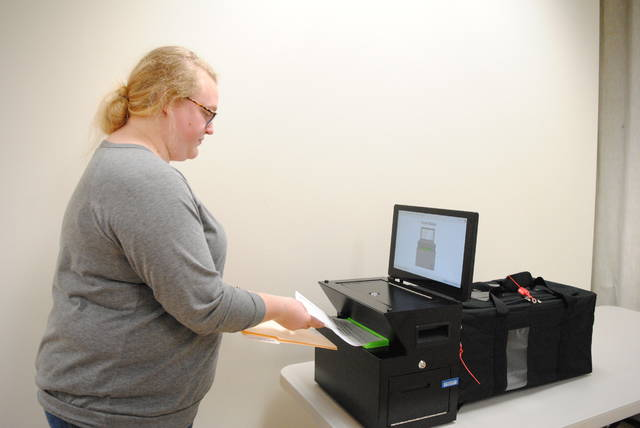 Casey Carter, Highland County Board of Elections clerk, demonstrates how to use the new ClearCast voting machine.