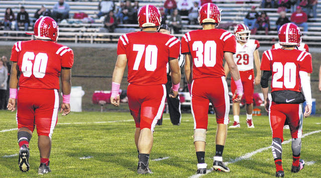 Hillsboro Indians seniors L-R Zach Burns, Draven Stodgel, Logan Hester, and Justin Spears walking out as captains for the coin flip on their last football game at Richards Memorial Field shown in photo above