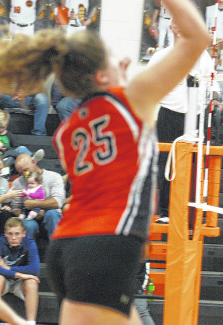 Cylee Bratton puts the ball over the net for Whiteoak in this picture.