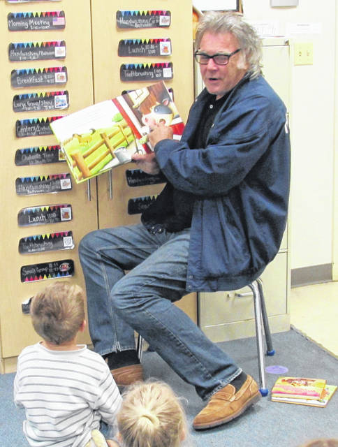 A new dad in his own right, Hillsboro Mayor Drew Hastings took some time Thursday to read to Miss Rachel's and Miss Nicki's Head Start class. Hastings told The Times-Gazette he wanted to help instill a love for reading in children, saying that he felt they were never to young to learn to read.