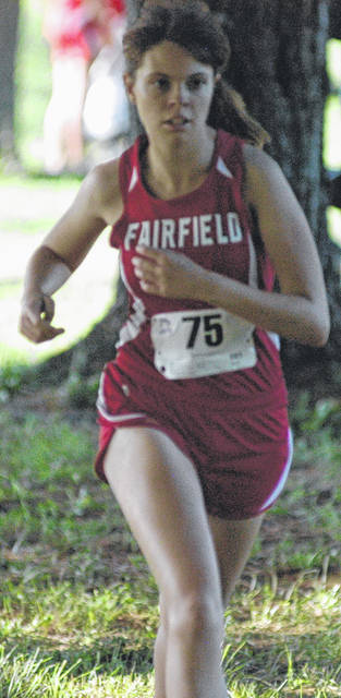 Ciara Colwell races at the McClain Cross Country Invitational earlier in the season.