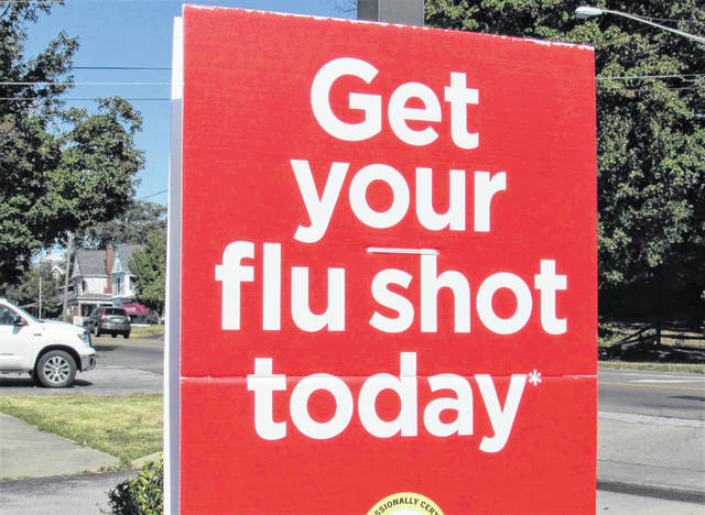 One of the many signs from pharmacies and grocery stores that are visible throughout Hillsboro advertising the availability of flu shots is shown in this picture.