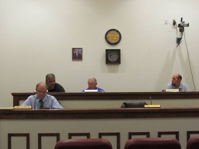 Greenfield Councilman Eric Borsini (far right) speaks during Tuesday's council meeting. Also pictured are (l-r) council members Phil Clyburn, Chris Borreson, and Bob Bergstrom. Councilman Mark Clyburn was absent from the meeting.