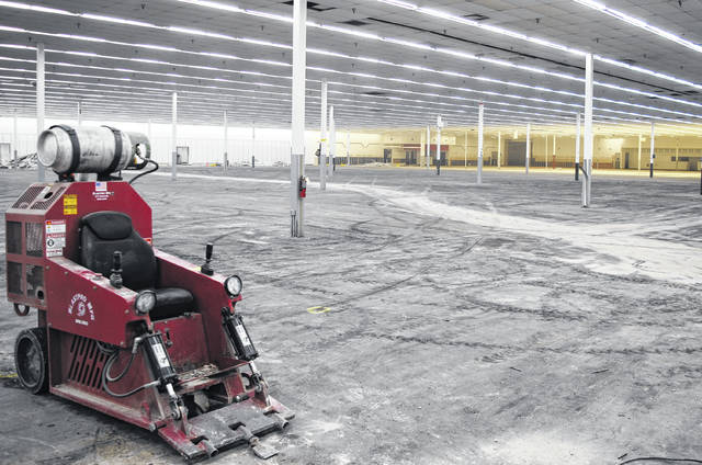 Work is progressing on the inside of the former Hillsboro Kmart building, with workers resurfacing the floor and revamping the interior to Rural King's configuration.