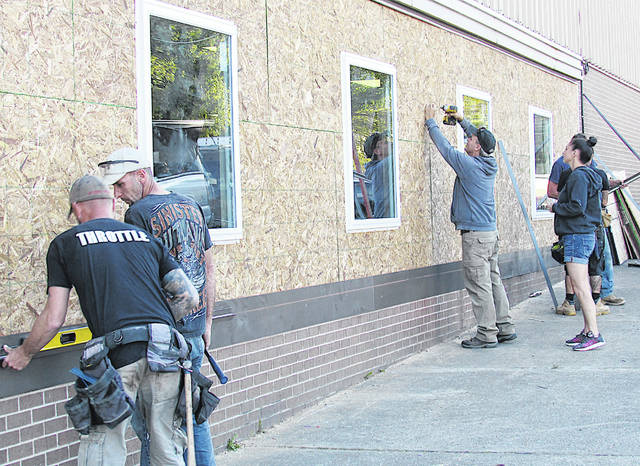 ServiceMaster by Jeff Burnett personnel work Tuesday on the front of the Highland County Senior Citizens Center.