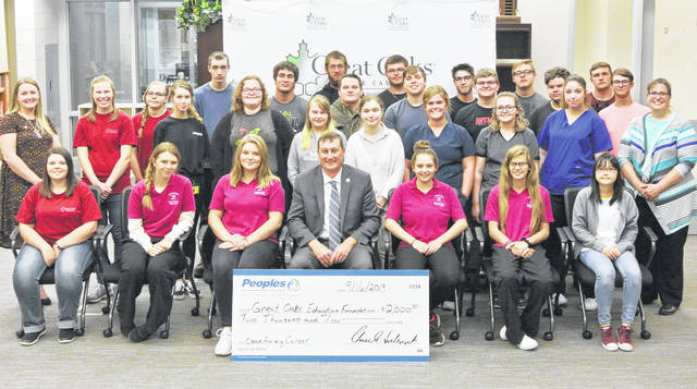 Some of the Laurel Oaks students that showed up for a check presentation for the school's Clean for My Career program are shown in this picture.