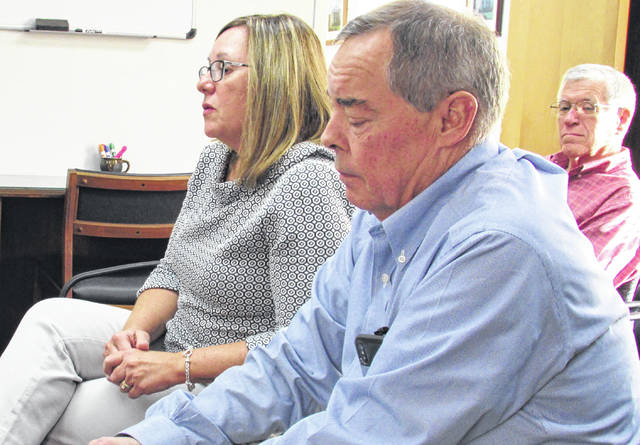 Briefing commissioners Wednesday on the most recent appraisal of county properties and projected insurance costs were, from left, Ali Redmond of CORSA and Todd Heskett of the Heskett Insurance Agency, with Highland County Auditor Bill Fawley looking on.