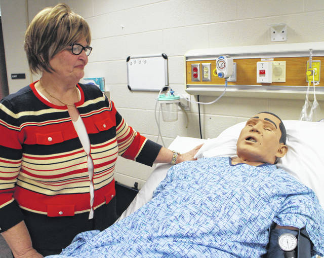 Julie Krebs sets up a nursing mannequin at Southern State Community College in Hillsboro.