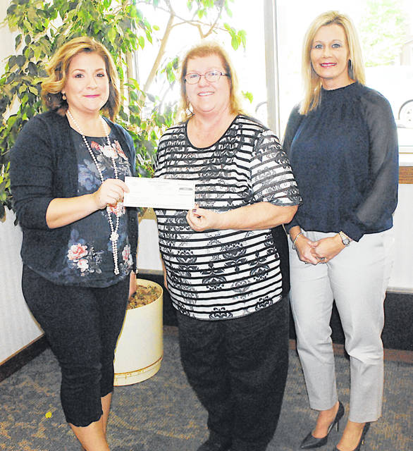 Heather Collins, left, director of the Highland County Victim Witness Office, accepts a $500 donation for the office from Merchants Bank representatives Bertha Hamilton, center, chairman's secretary, marketing and HR, and Denise Fauber, vice president of branch administration.