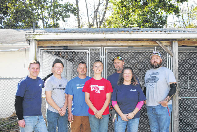 On Saturday, Oct. 19, seven volunteers donated their time to replace the Highland County Humane Society Animal Shelter's chain link panels and stall fronts, which Humane Society General Manager Kamela Kordik said were originally installed at the Humane Society when it was first started in 1969. Pictured, from left, are Mason Company Plant Manager Troy Brown, Hunter Burns, Mason Company teammates Jeremy Cox, Isaac Burns and Tony Burns, Mason Company accounting teammate Janie Burns, and Mason Company teammate Lige Tyler.
