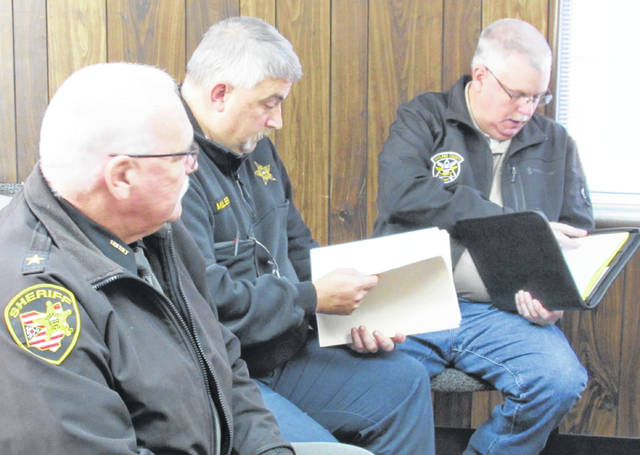Fom left, Highland County Sheriff Donnie Barrera, Deputy Scott Miller and EMA Director David Bushelman brief commissioners on 9-1-1 upgrades Wednesday.