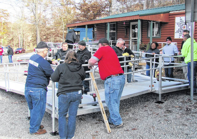 Volunteers and personnel from Operation: Ramp It Up For Veterans gathered at the home of Vietnam veteran Jack Wilson Monday morning to construct an access ramp at his home at Woodland Lake on West Deadfall Road.