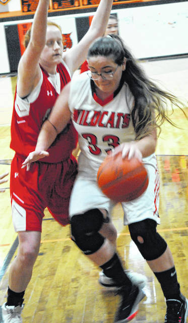 Lady Wildcats Lizz Edwards driving in for a layup attempt in the Whiteoak and East Clinton matchup in photo shown above