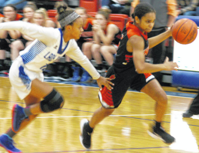 The Whiteoak Lady Wildcats Kensley Price driving past Lady Blue Jays Azyiah Williams during the 31-7 loss to Ripley during the preview on Nov. 15.