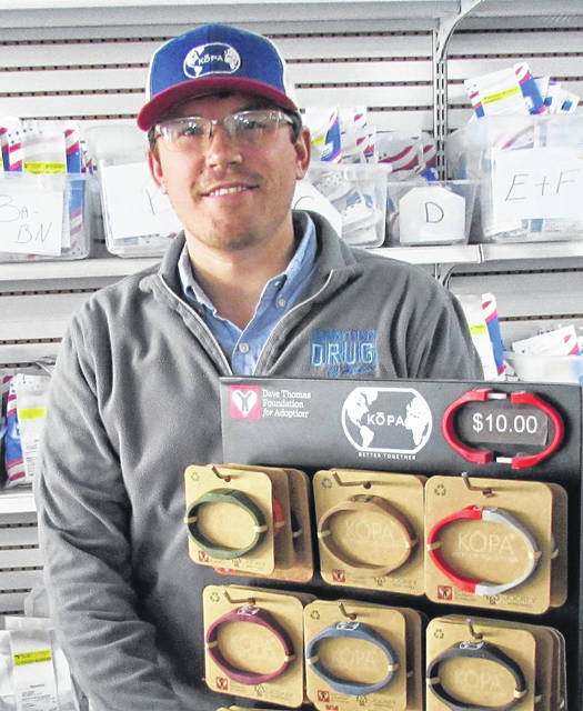 KOPA Founder Dane Allard shows KOPA bracelets on display and for sale at Downtown Drug in Hillsboro.