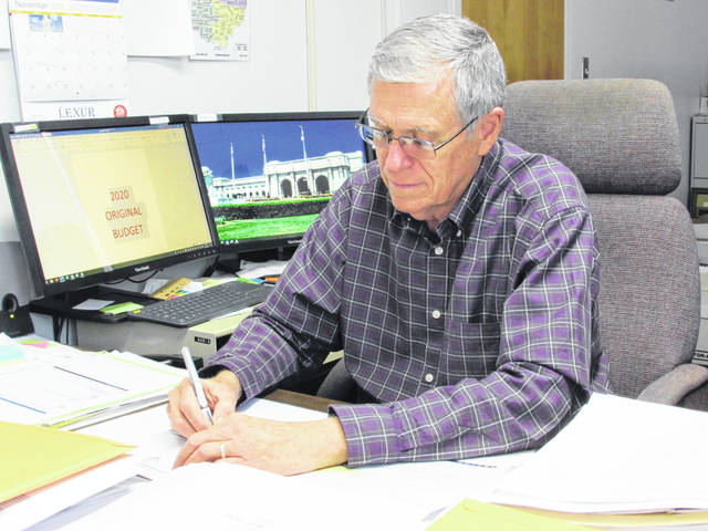 Highland County Auditor Bill Fawley is pictured Wednesday at this desk in the Highland County Administration Building.