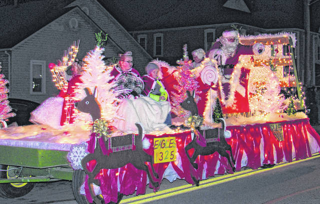 Santa and Mrs. Claus wave from a Greenfield Eagles 1325 float in a scene from a previous Eagles Christmas Parade.