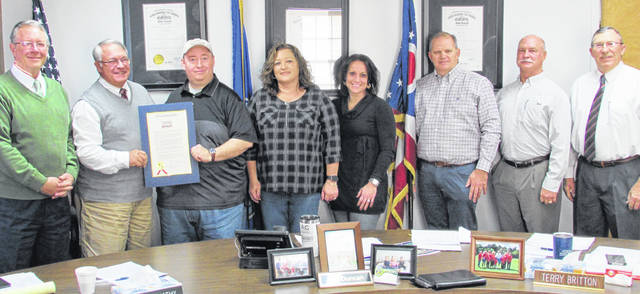 The Highland County Board ofCommissioners proclaimed the week of Nov. 16-24 as National Hunger and Homelessness Awareness Week during Wednesday's meeting. Shown, from left, are commissioners Gary Abernathy and Jeff Duncan, Homeless Shelter Executive Director Greg Hawkins, Tammy DeLong, Amatha Farrens, Scott Lewis, Mike Banks and commissioner Terry Britton.