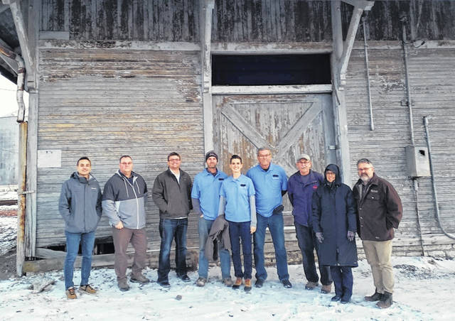 Pictured, from left, are Valero employees Peter Whiteman, engineering intern; Sterley Lightner, process operator; Zach Beversdorf, plant manger; Leesburg Area Historical Society officers Raymond Friend, vice president, and Nicole Friend, publicity; Ken Worley, president; John Noftsger, treasurer; Alice Teeters, secretary; and Doug Karnes, construction administrator from McCarty Associates. Absent from the picture is Candy Horton, office coordinator with Valero. They are pictured in front of the more than 100-year-old Leesburg depot.