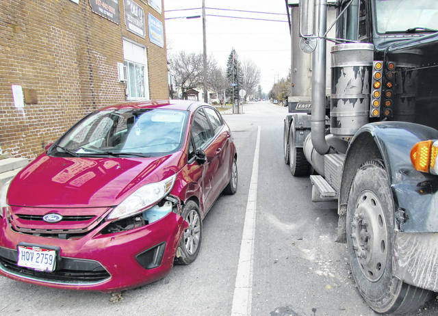 No one was injured but a Ford Fiesta suffered moderate damage following a collision between it and a Peterbilt tractor trailer rig Monday afternoon in Mowrystown. Witnesses on the scene told The Times-Gazette that the semi was westbound on SR 321 when after stopping at the intersection, the driver proceeded to make a left turn onto Mowrystown-Sardinia Road and collided with the car. A witness said the driver of the Fiesta unexpectedly pulled out into the path of the semi, which then impacted the car causing moderate damge to the driver's side and front bumper of the vehicle. The identities of the drivers involved and whether any citations were issued were unknown as the investigation was ongoing.