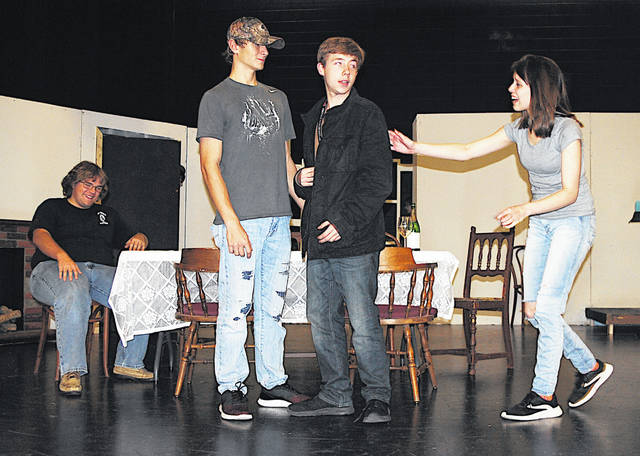 "Hillsboro High School actors, from left, Bryce Bledsoe, Nick Mahaffey and Nyssa Reno, are pictured rehearsing for their Nov. 15-17 production of ""You Can't Take It With You."""