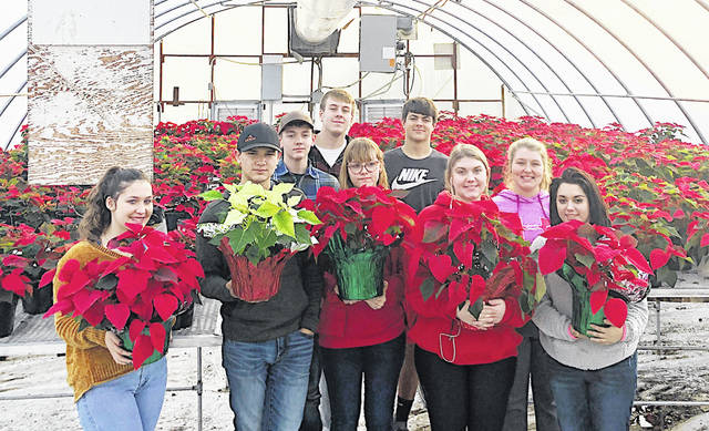 The Hillsboro FFA Chapter is preparing for its annual poinsettia sale. It is selling red and white poinsettias for $10 apiece or $8 a piece if you get three or more. The sale runs Nov. 26 through Dec. 16. To order, call 937-393-3485 ext. 1580 or email emcneal@hillsboro-indians.org. The poinsettias can be picked up at the highschool greenhouse during school hours or can be delivered to your business. PIctured, from left, are Loraleigh Mayhan, Cameron Elkins, Kieran Conlon, Caleb Crawford, Abigail Ahrmann, Shane Sullivan, Addie Hildebrecht, Christine Page and Katherine Mizzi.