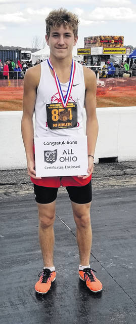 Cohen Frost with his awards after his top 20 finish at state shown above