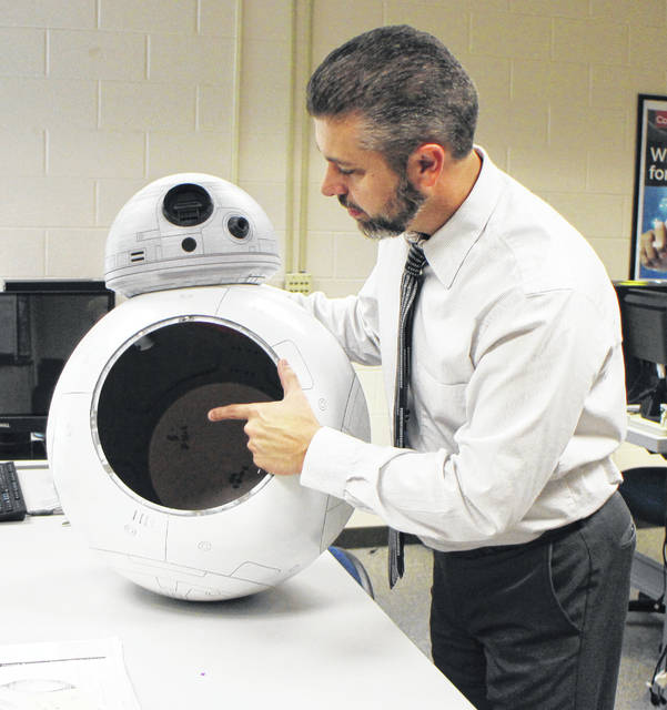 Josh Montgomery displays an automated Star Wars droid at Southern State Community College in Hillsboro.