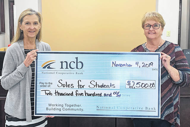NCB recently donated $2,500 to Soles for Students. The organization works with Highland County schools and businesses to provide students with shoes at no cost to the student. Pictured are Sue Davis (left) founder of Soles for Students, and Tammy Irvin, NCB branch manager.