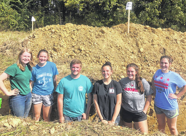 "The Soil Judging Team from the Hillsboro FFA Chapter recently went to Marysville to compete in the State Soils Contest. The team included Claire Wilkin, Katie Craig, Joe Helterbrand and Alora Brown. Throughout the contest each member must express their knowledge on soil quality and structure while determining if the soil is adequate enough to support crop life. Helterbrand placed 34th individually, and Alora Brown placed 42nd. In the district competition, the Hillsboro FFA Soils team placed fifth. Helterbrand said, ""I had an amazing time at the state contest and I enjoyed hanging out with the soil team."" The Soil Judging Team from the Hillsboro FFA Chapter placed 15th overall. Pictured, from left, are Craig, Brown, Helterbrand, Taylor Gaible, Wilkin, and Lora Mayhan after they competed in the soil competition."