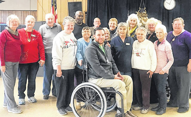 Tylers Ayres, seated, with Moderen Woodmen, a financial service organization, is pictured with Highland County Senior Citizens members after making a $2,500 matching fund donation to the center. The center matched the funds with its recent Healthy Halloween: Senior Health & Information Expo.