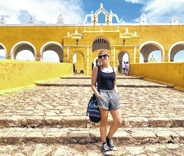 "Becca Strider, pictured above, says, ""The beautiful 'magic yellow city,' called Izamal, was one of my favorite places I visited. Every building here was yellow, even the church behind me."" The city is located in the Mexican state of Yucatán."