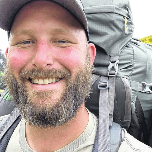 U.S. Army veteran Jeremy Miller is shown shortly after beginning his walk across the country.