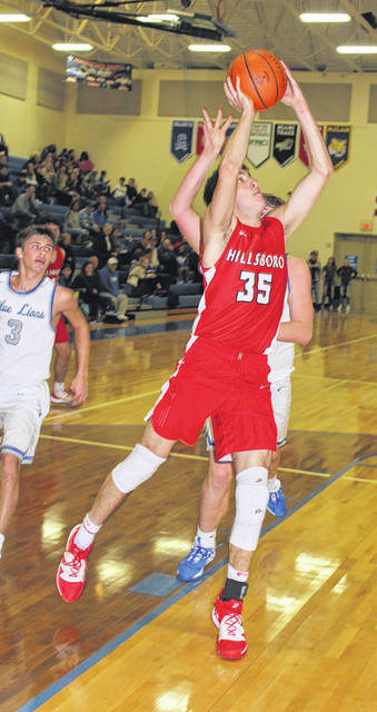 Brad Miller going up for a layup against Washington Courthouse Blue Lions in photo shown above