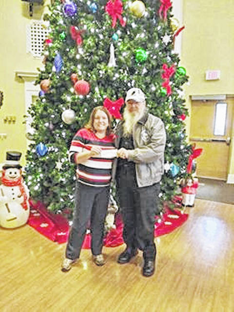 Gerold Wilkin, right, representing local Amvets Post 61 on North Shore Drive, is pictured donating $500 to the Chillicothe VA recently for art supplies.