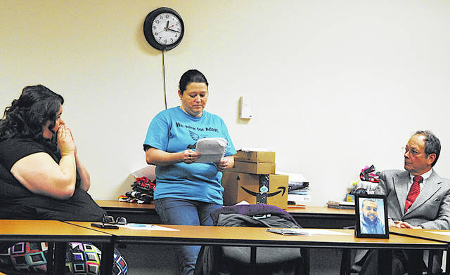 Amber Beavers (center), a nurse at Adena Greenfield Medical Center, shares her brother Adam's story at Thursday's Highland County Drug Abuse Prevention Coalition meeting. Adam was 25 and had been clean for nearly two years when he fatally overdosed on heroin in April. Beavers started Adam's Hope in his honor.