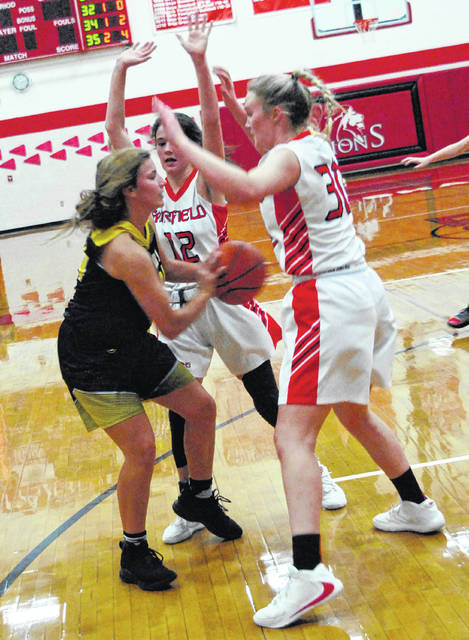 Mustangs' Kaylee Lunsford being double team by Fairfields' Peyton Magee and Braylynn Haines