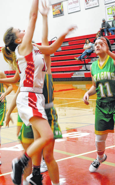 Fairfield Lady Lions Emma Fouch going up for the ball in photo shown above.