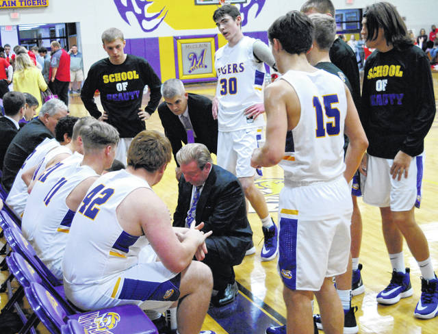 Coach Joe B. Stewart talking to his McClain team during a timeout in photo shown above.